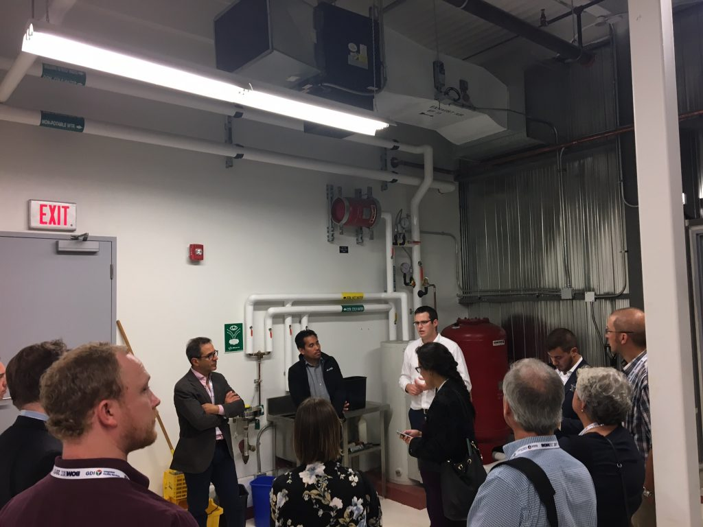 A group of people in a building maintenance facility