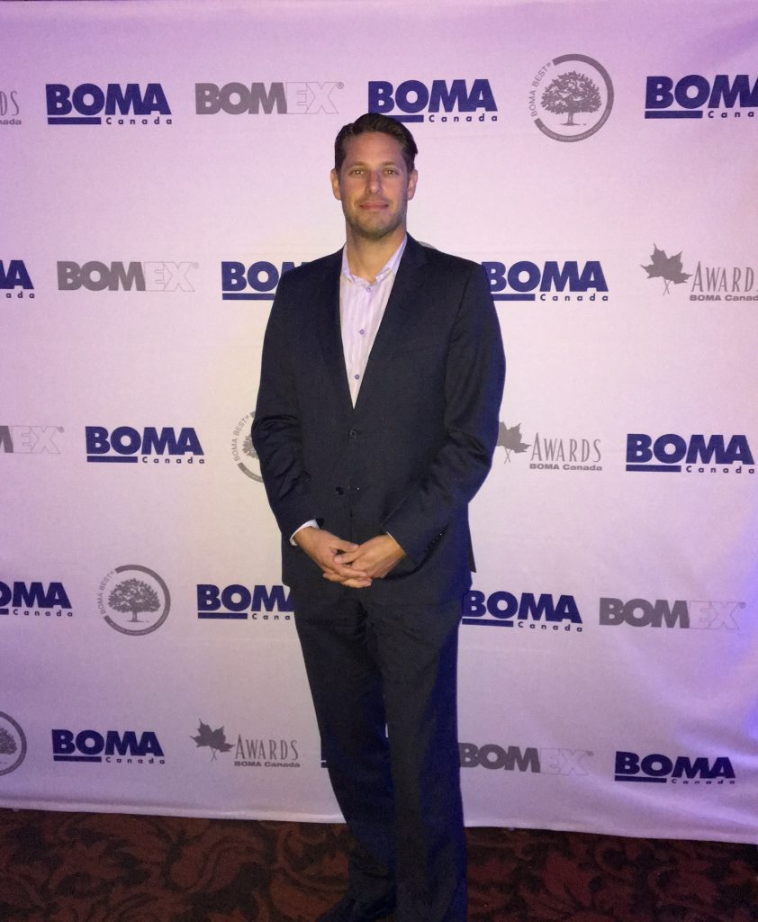 CIET Canada, Olivier Cappon standing in front of a BOMA Canada, BOMEX backdrop